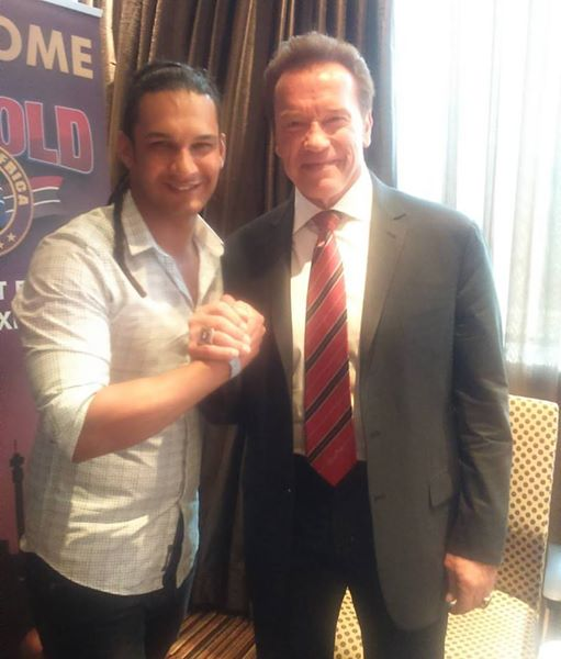 Jody Hendricks poses with Arnold Jody Hendricks and Arnold Schwarzenegger